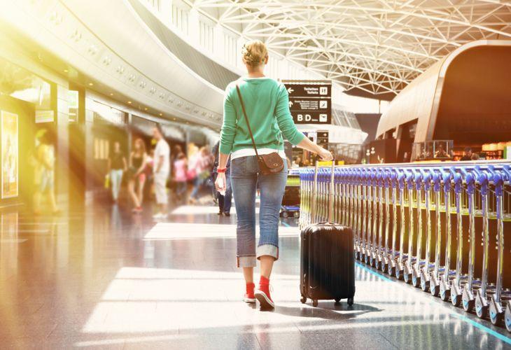 8-Airport-Girl-Suitcase-AdobeStock_79763070.jpg